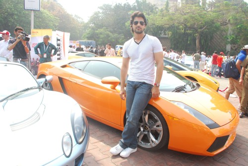Arjan Bajwa posing with Gallardo Coupe
