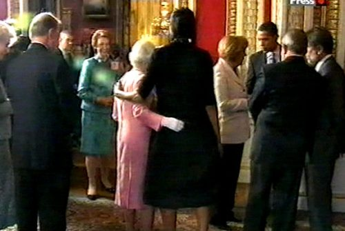 US first lady Michelle Obama, center, right, stands with her arm around Britain's Queen Elizabeth II during a reception at Buckingham Palace
